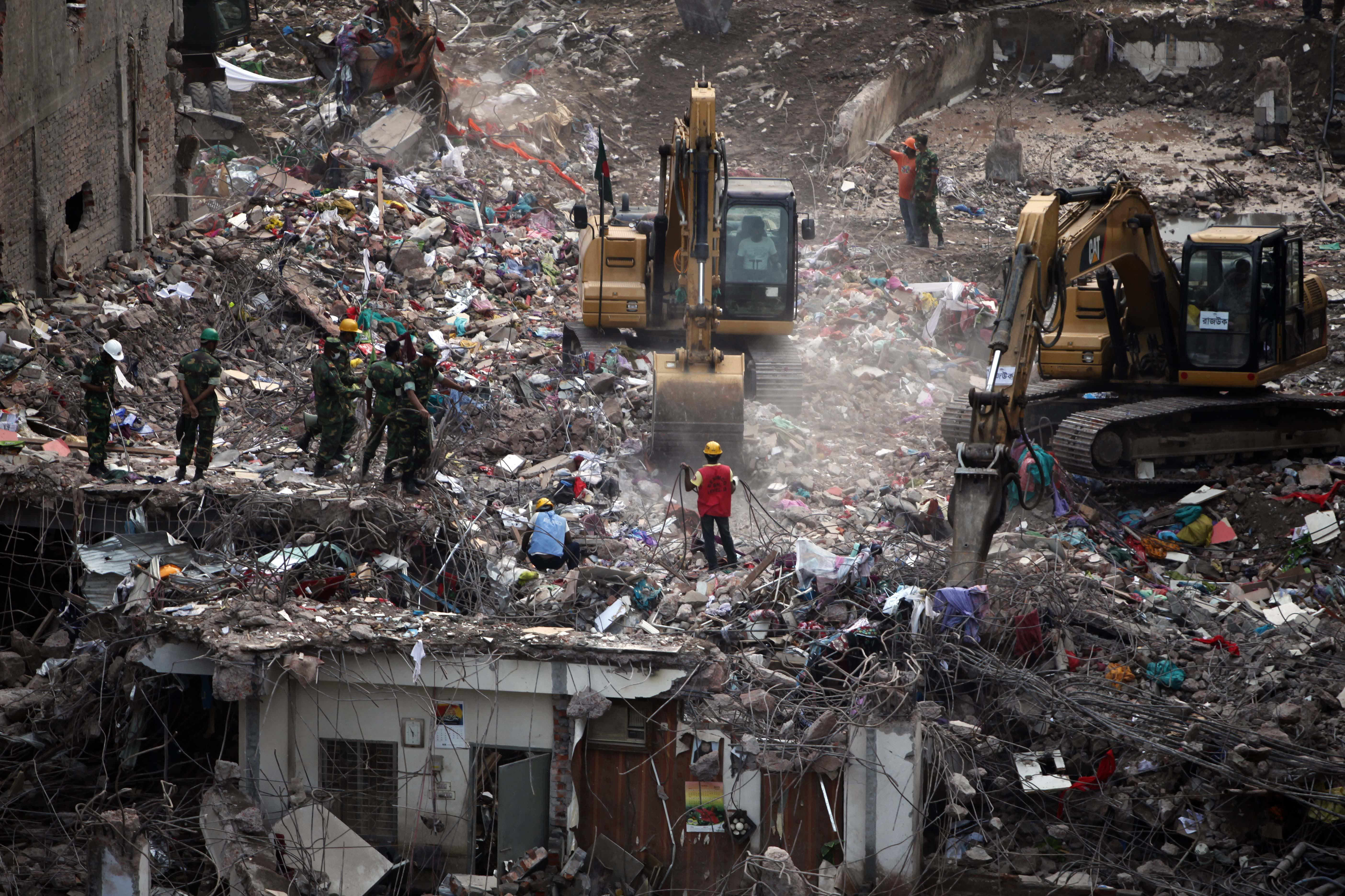 Search for bodies at Bangladesh factory collapse ends, death toll at 1,127