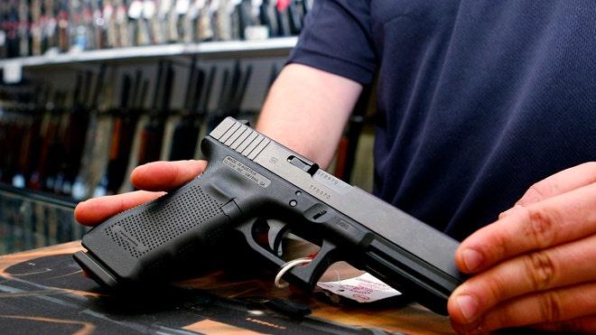 Georgia governor signs 'unprecedented' bill expanding gun rights