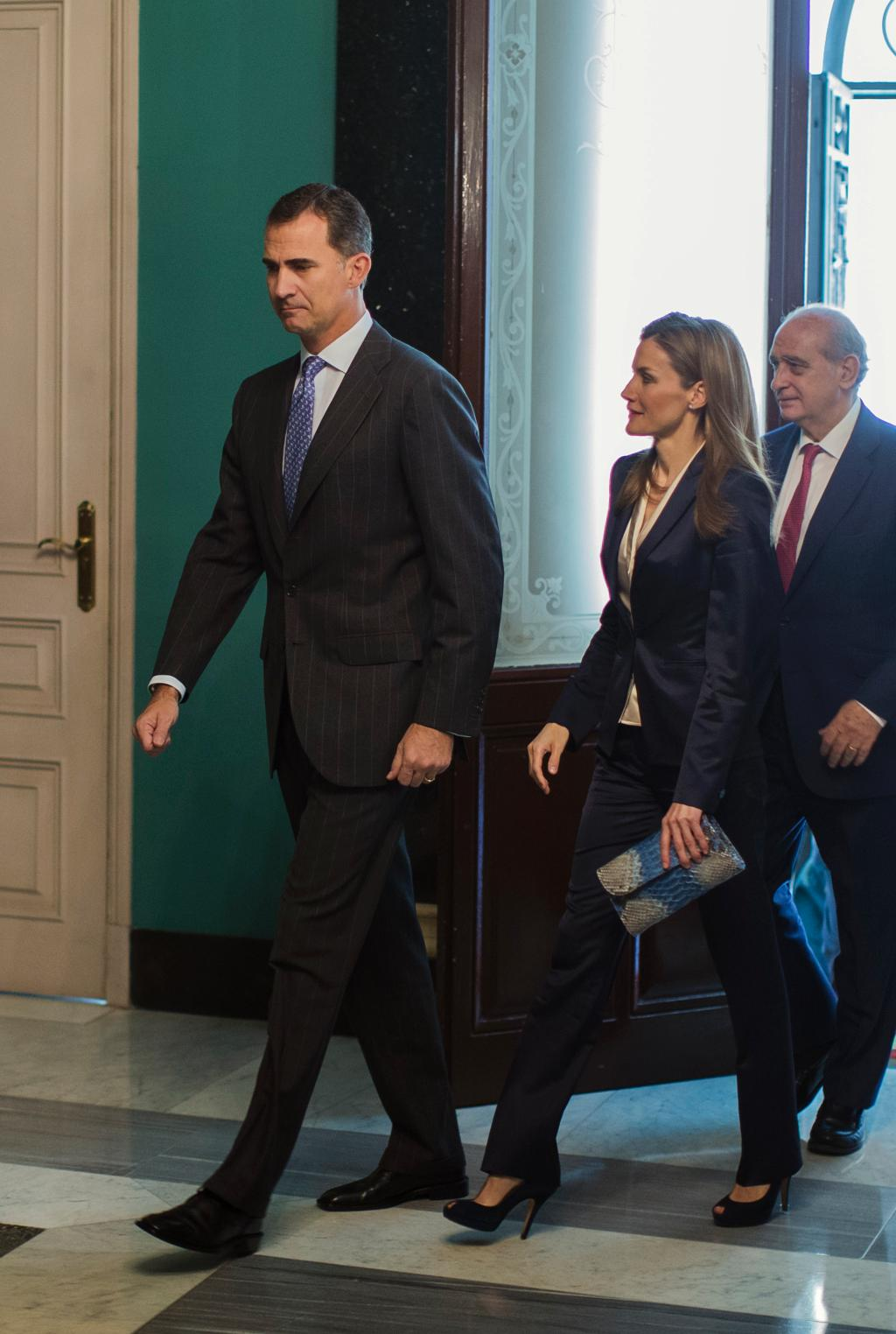 Spain's new King Felipe meets with victims of terrorism at 1st official act with Queen Letizia