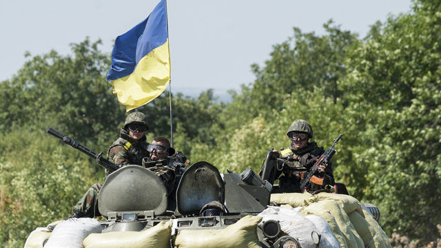 Ukraine president says he'll consider aid mission as Obama, Merkel warn Russia not to intervene