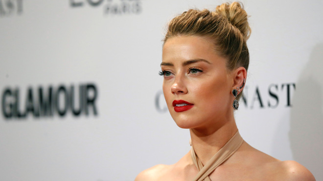 Amber Heard bashes Instagram no-nipple policy using Aquaman co-star Jason Momoa's chest