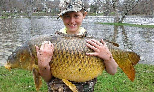 Vermont boy reels in record-breaking carp