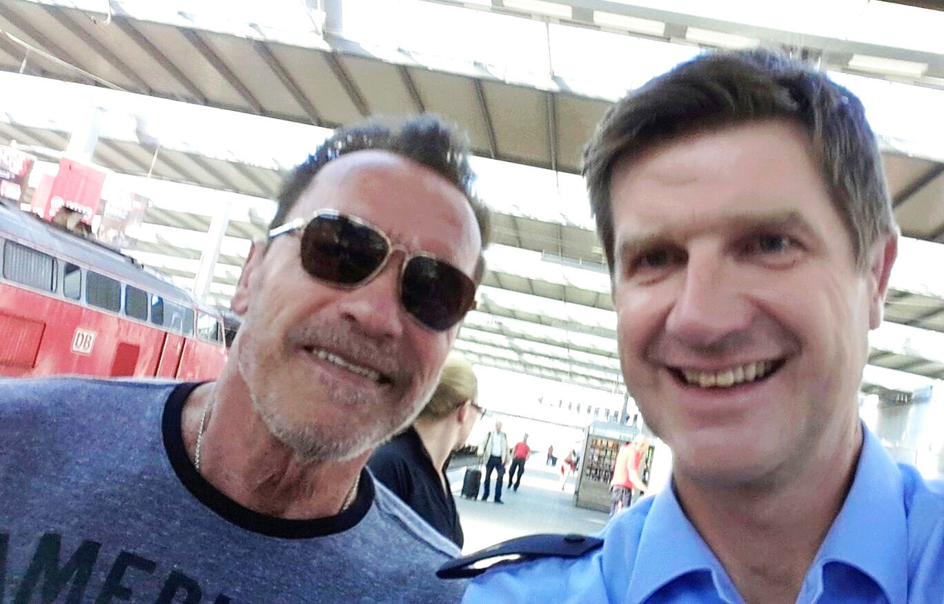 Police stop Arnold Schwarzenegger riding bike in Munich station