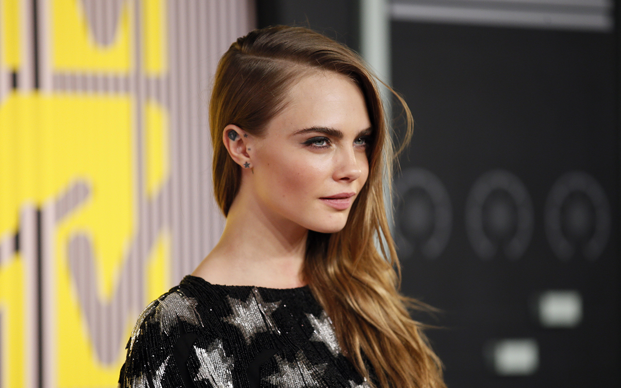 Cara Delevingne says Harvey Weinstein told her she'd never make it in Hollywood 'as a gay woman'.