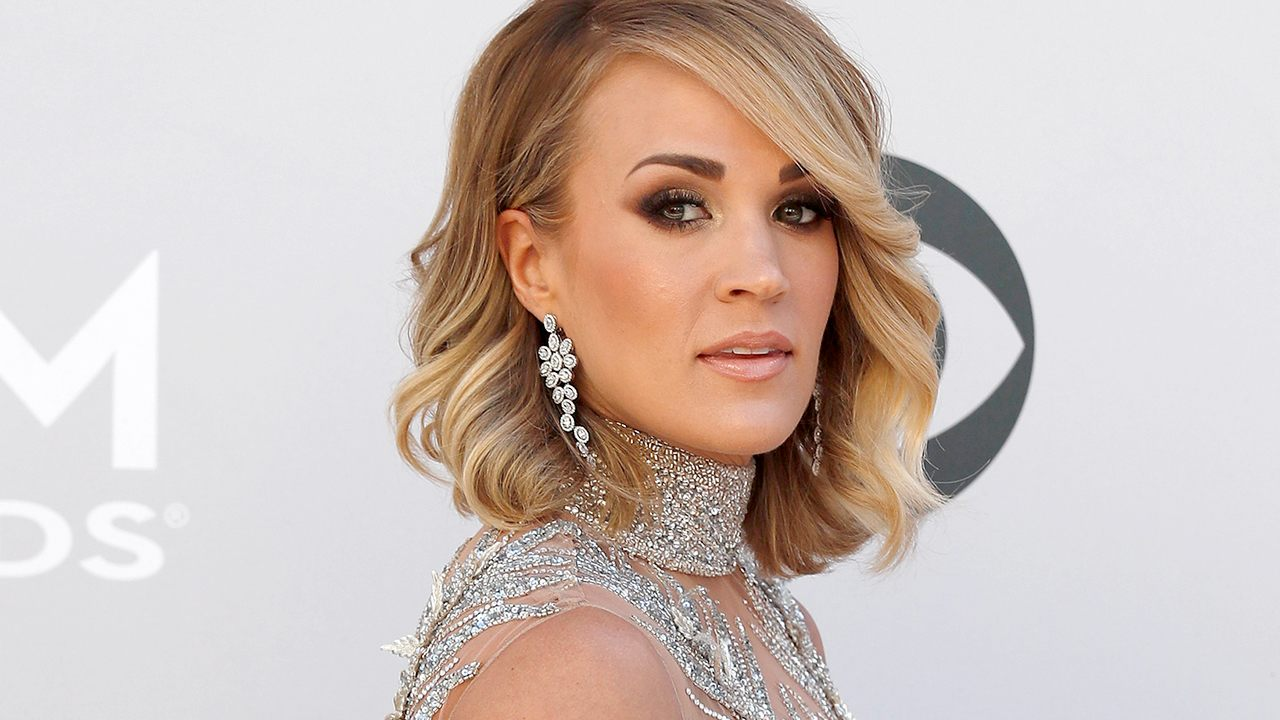Carrie Underwood says son, 4, thinks she's 70, her job is to 'wash the laundry' in hilarious school assignment thumbnail