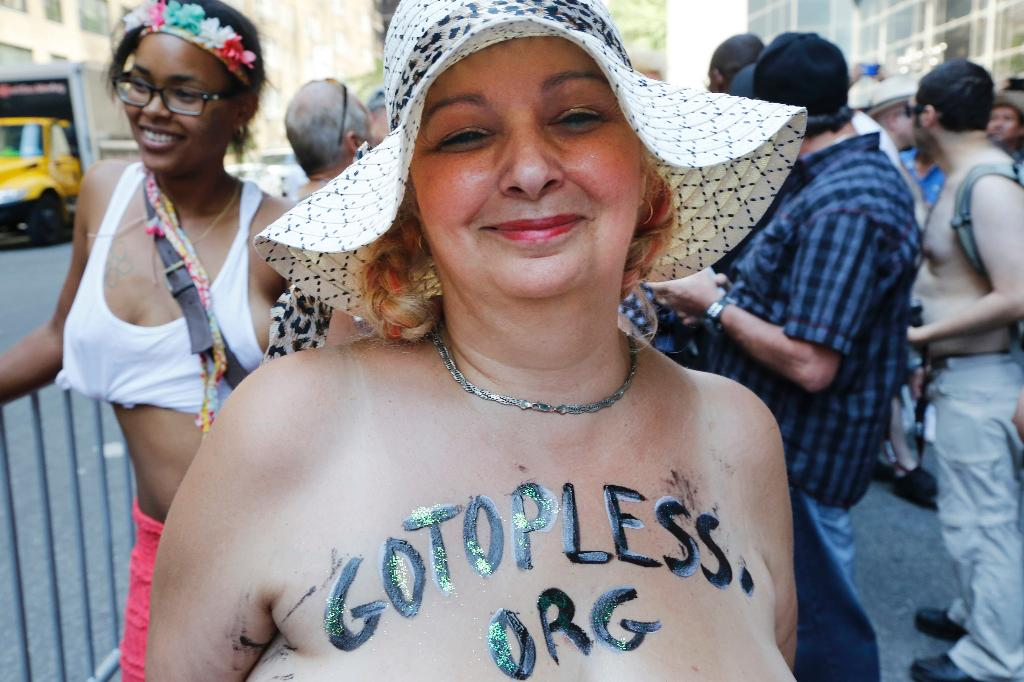 Women bare breasts for equality in New York City