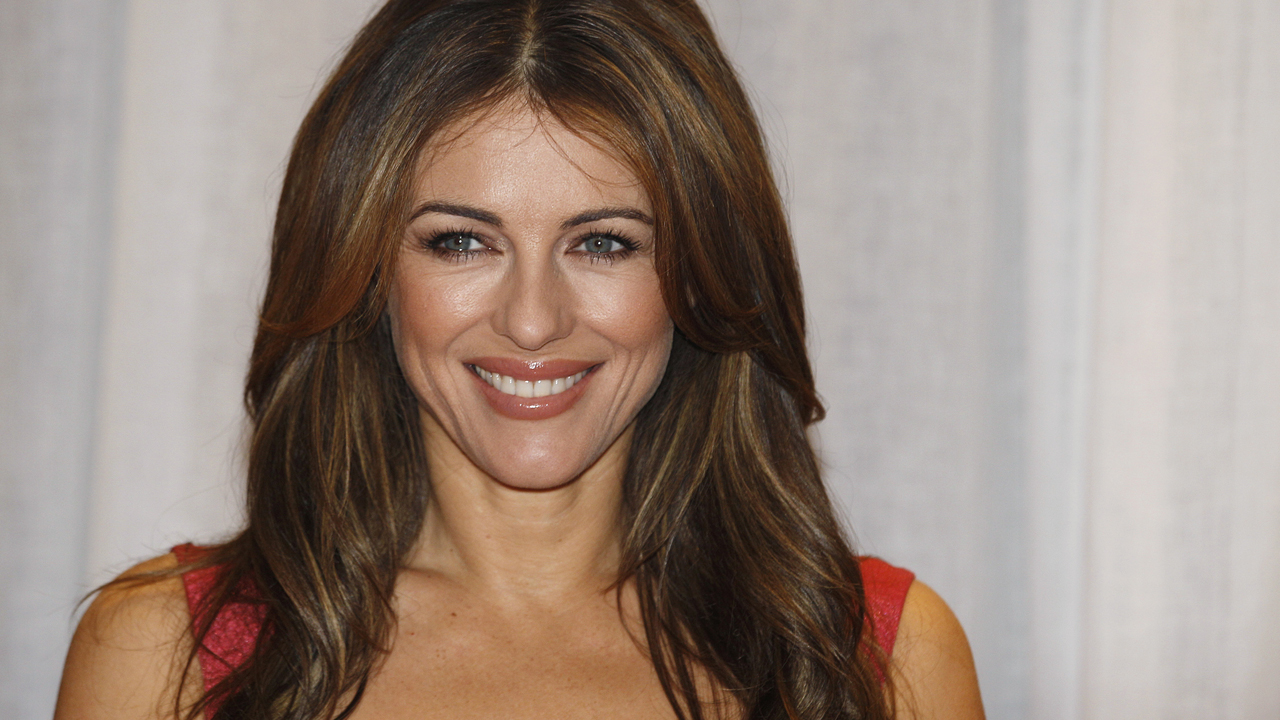Elizabeth Hurley shares video of herself swimming topless