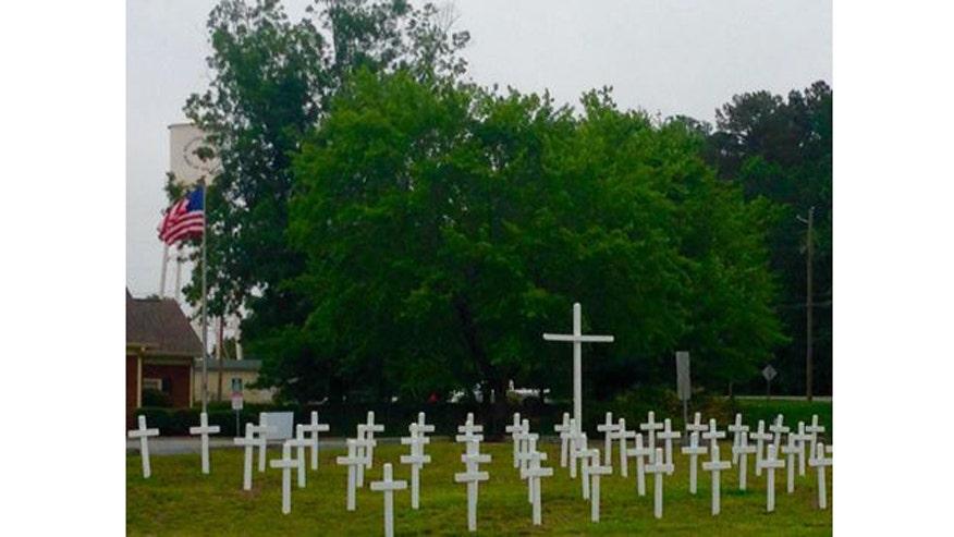 Cross memorial for fallen veterans back up after public outcry