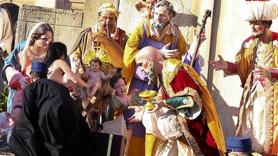Topless female activist tries to swipe baby Jesus statue from Vatican Nativity scene