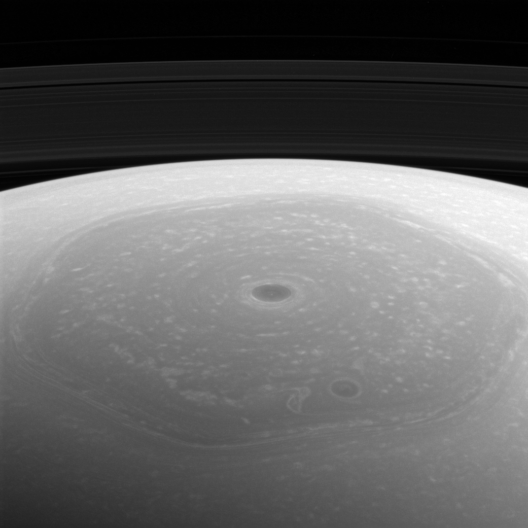 Bizarre Saturn hexagon, vortex star in Cassini photo
