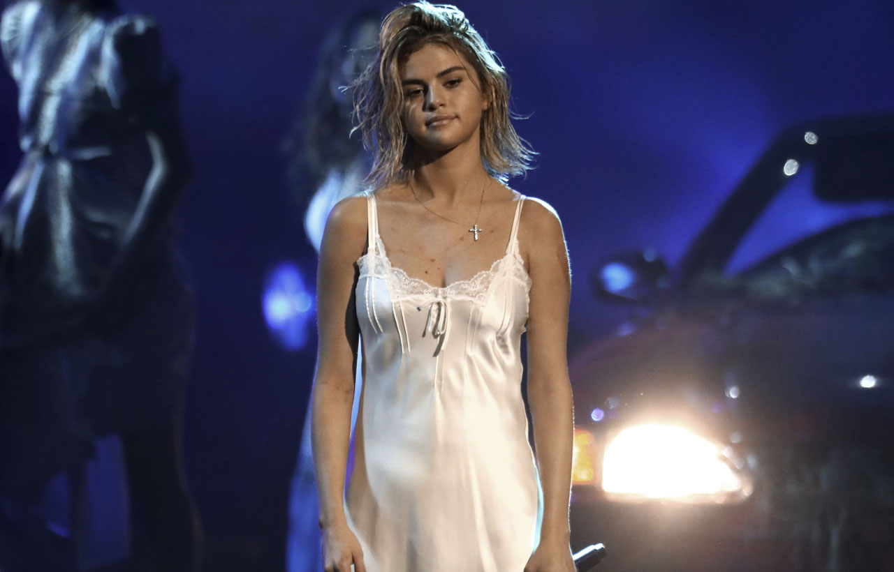 Selena Gomez 'seeking treatment' to 'tackle her emotional issues head-on,' source says