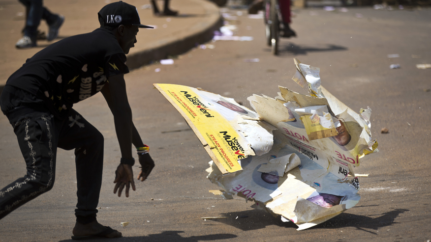 Uganda presidential candidate arrested during chaotic election, aide says