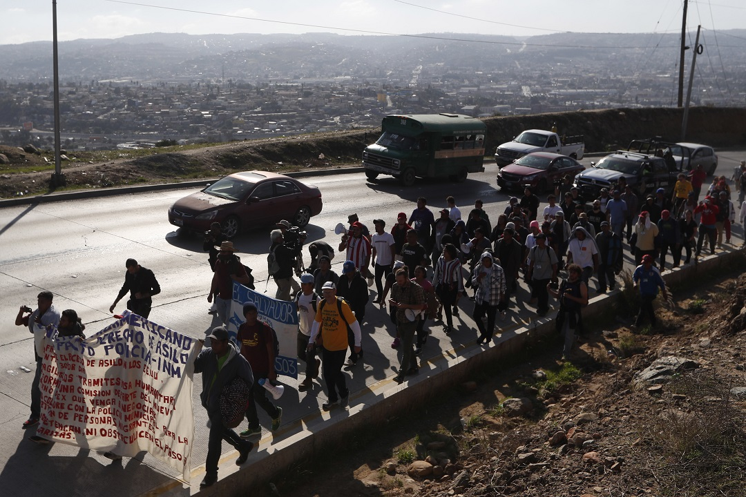 Migrant group demand Trump either let them in or pay them each $50G to turn around: report