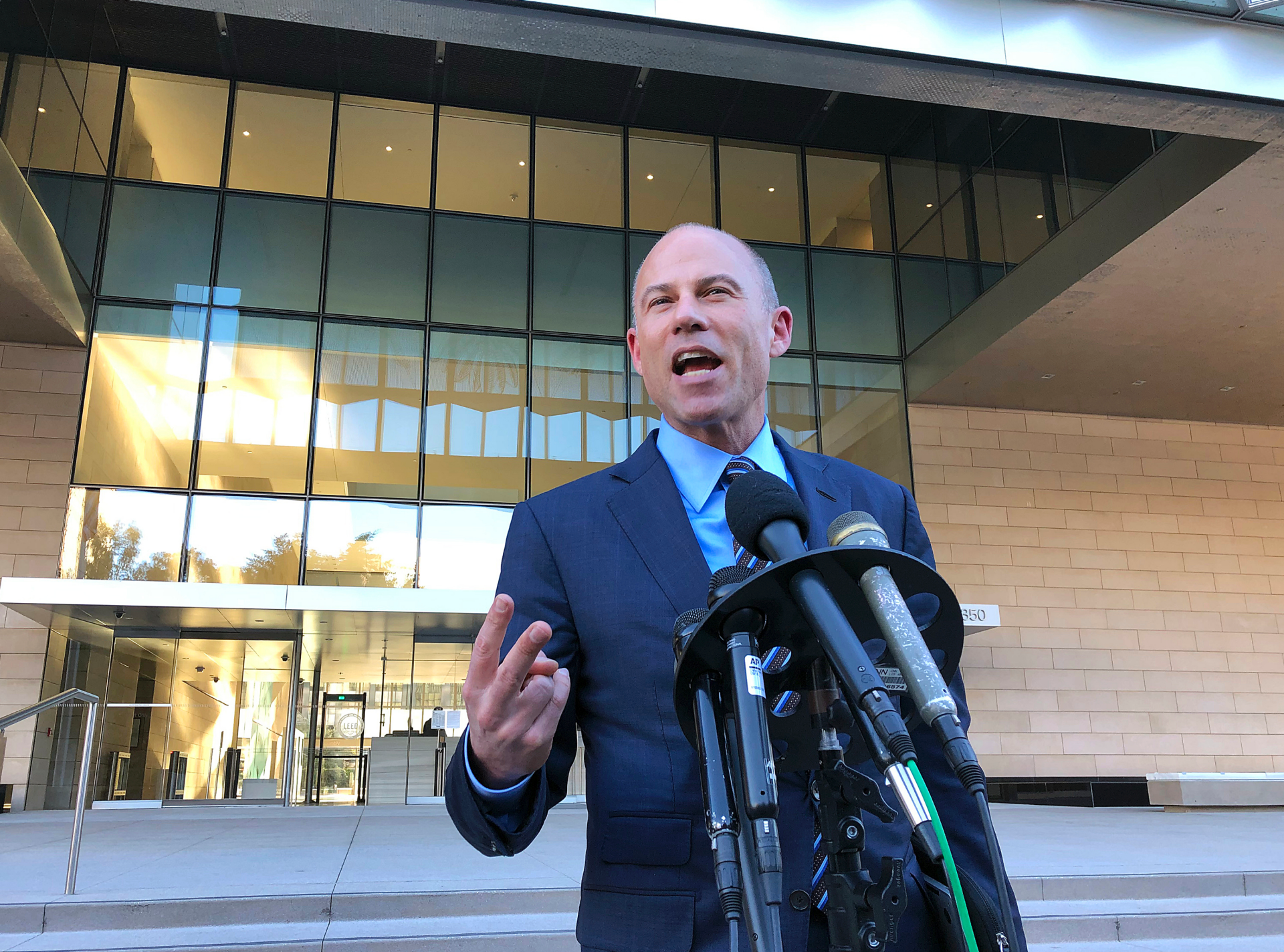 Avenatti agrees to give up assets to estranged wife