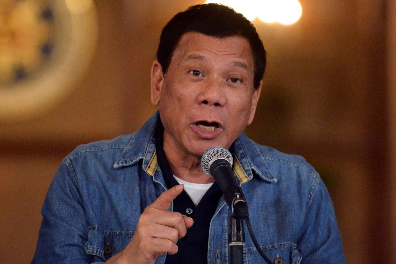 Philippines' Duterte threatens vaccine decliners with jail, animal drug