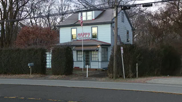 Pennsylvania couple found dead outside home with 'Happy Transmission' sign, officials say