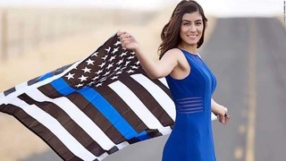 UC Davis students protest photo of slain police officer holding Blue Lives Matter flag