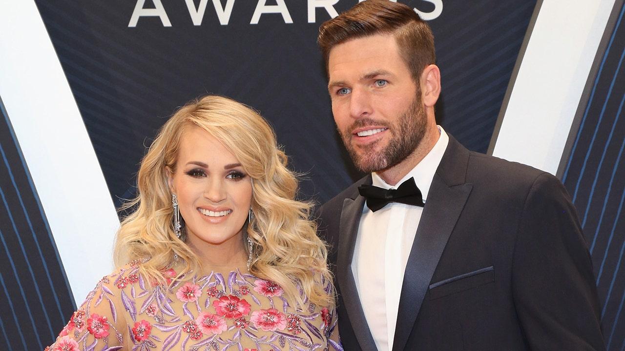Carrie Underwood chia sẻ bức ảnh ném ngược 'vụng về' của cô và Mike Fischer nhân kỷ niệm 10 năm