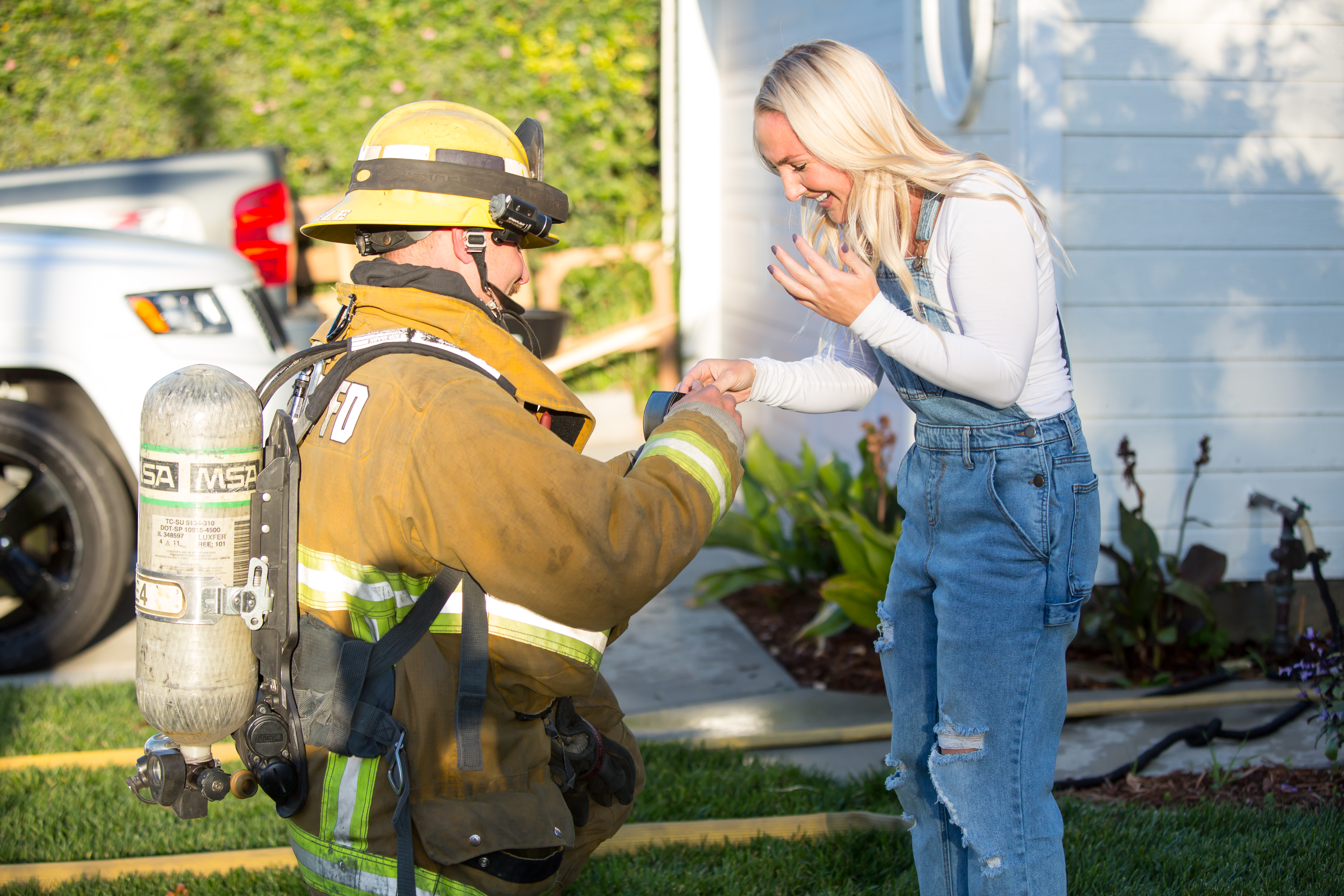 Firefighter stages dramatic blaze in his own home during family party to propose to girlfriend