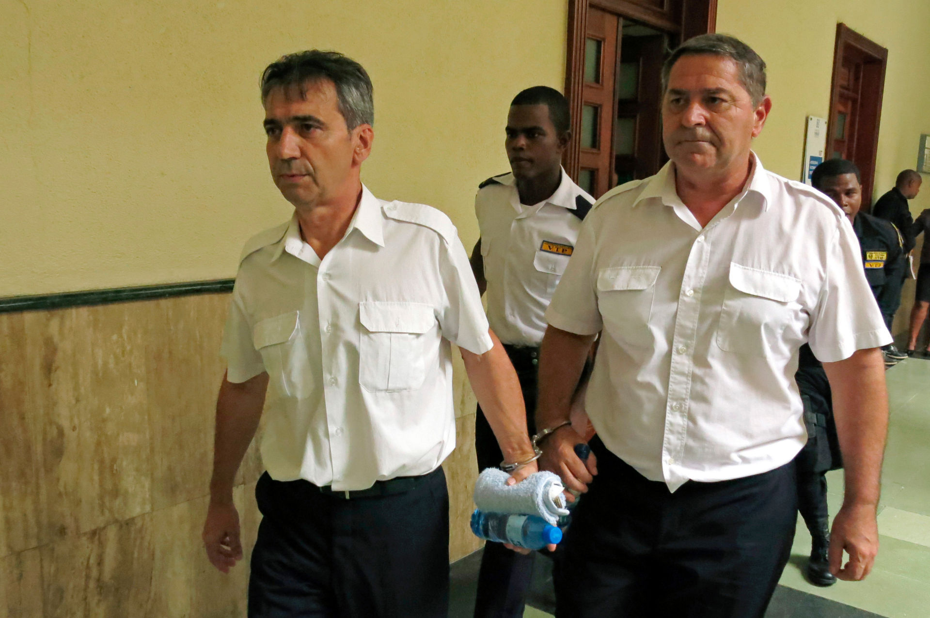 2 French pilots who fled Dominican Republic go on trial