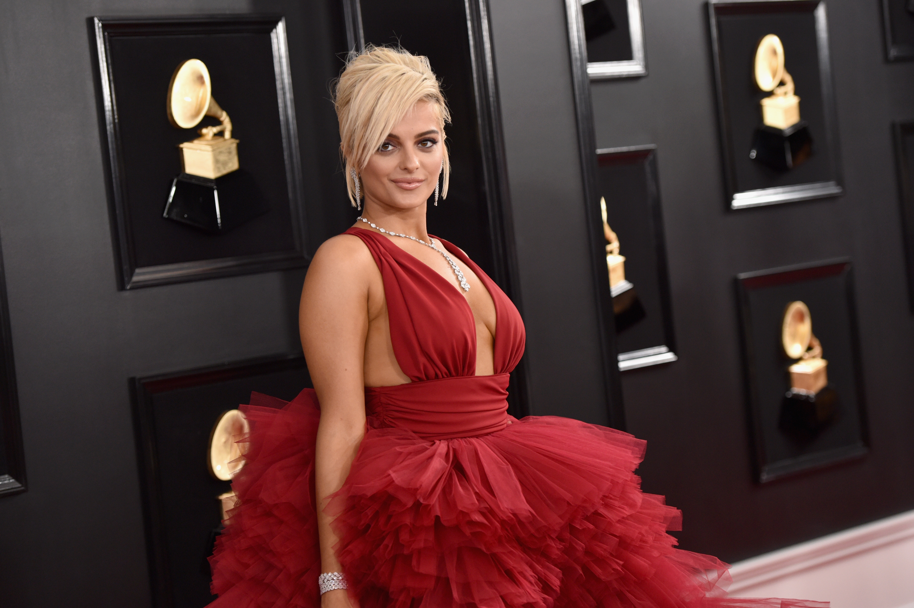 Bebe Rexha defends dad's pleas asking her to 'stop posting stupid pornography' thumbnail