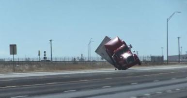 SEE IT: Strong winds blow over tractor-trailer traveling in Texas thumbnail