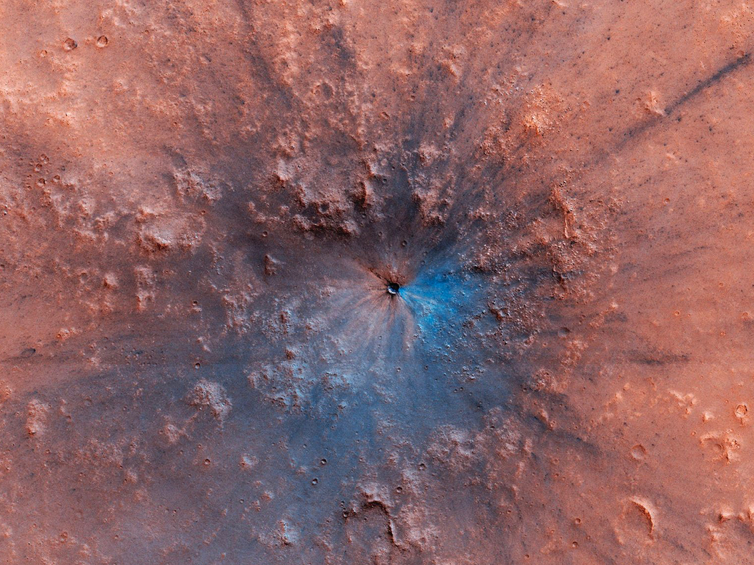 New Mars crater exposes mysterious darker material