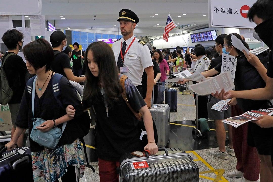 Westlake Legal Group AP19224659476724 Flights resuming at Hong Kong airport after protest chaos VINCENT THIAN fox-news/world/world-regions/hong-kong fox-news/world/world-regions/china fox-news/world/world-regions/asia fox-news/travel/general/airports fox-news/politics fnc/world fnc f85336e2-1615-5123-9258-8a8a9897f235 Associated Press article