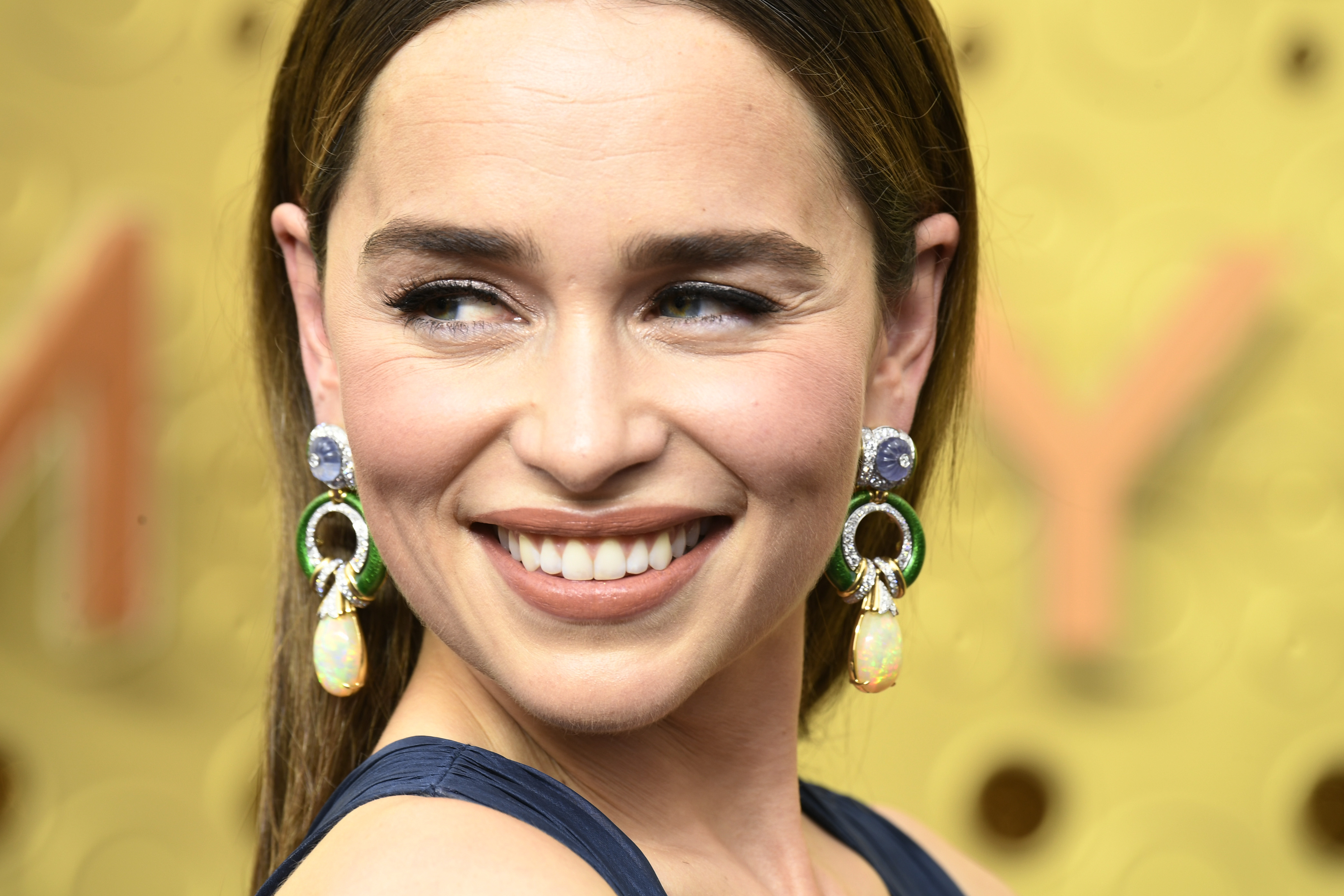 Emilia Clarke channels JLo at Emmy Awards, stuns in revealing gown