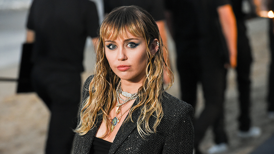 Miley Cyrus responds to critics of Cody Simpson, Liam Hemsworth and Kaitlynn Carter photo similarities
