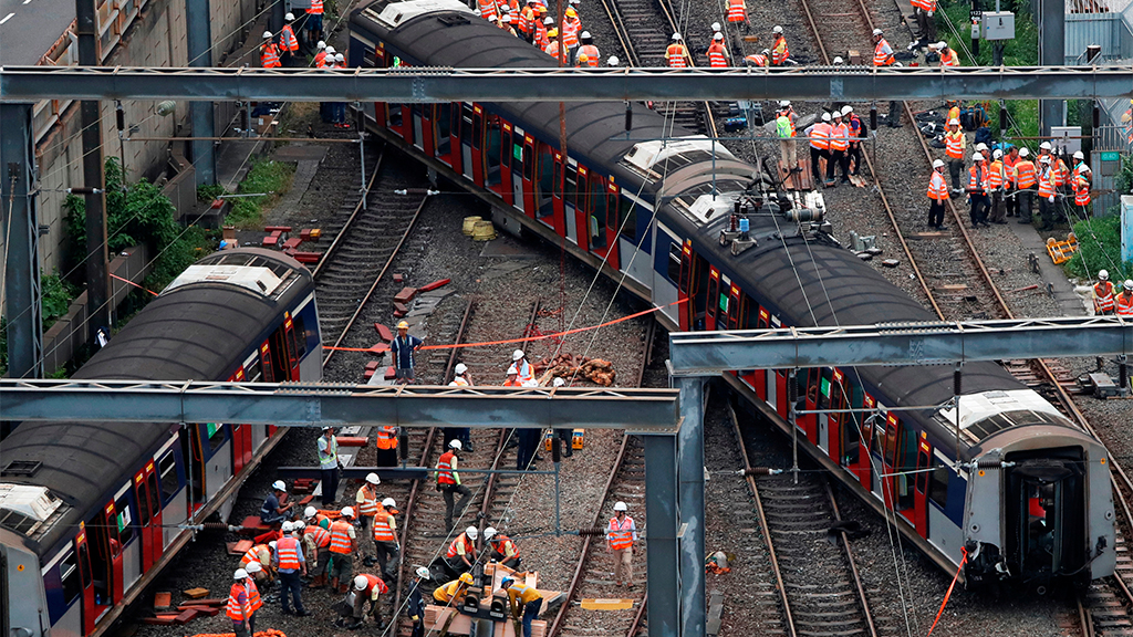 Rare Hong Kong train derailment injures at least 8 amid protests
