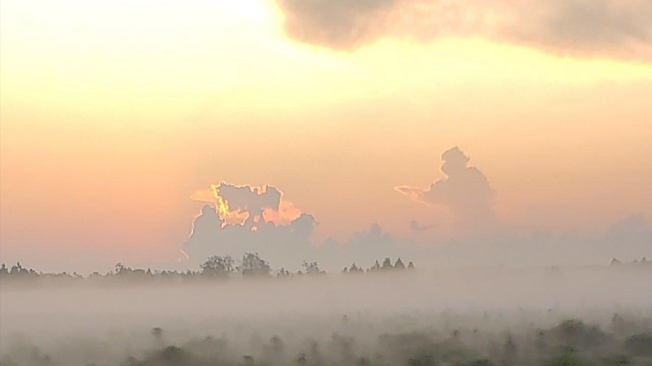 9/11 cloud formation shows firefighter walking toward angel