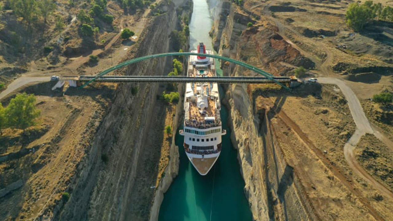 Cruise ship narrowly passes through Greek canal in historic first