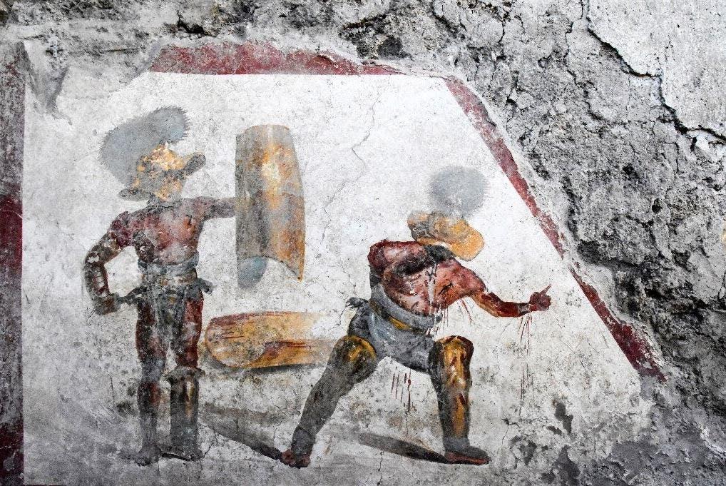 In Pompeii, scientists unearth gladiator fresco