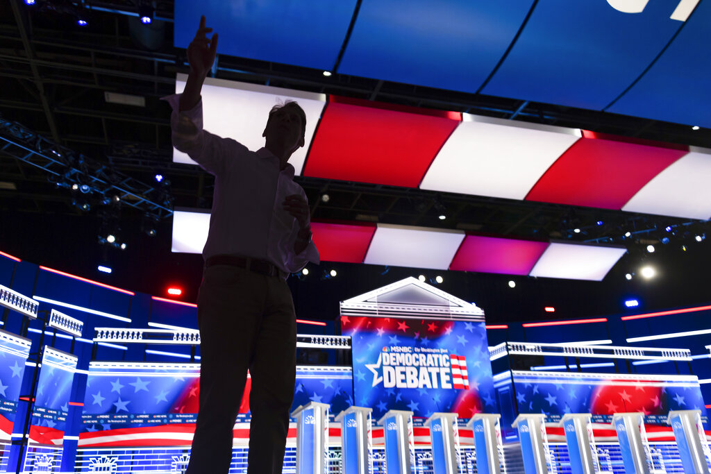 Impeachment takes center stage at Dem debate, as Warren takes aim at star witness Gordon Sondland