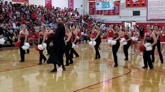 Dancing priest wows crowd during surprise routine at Florida high school