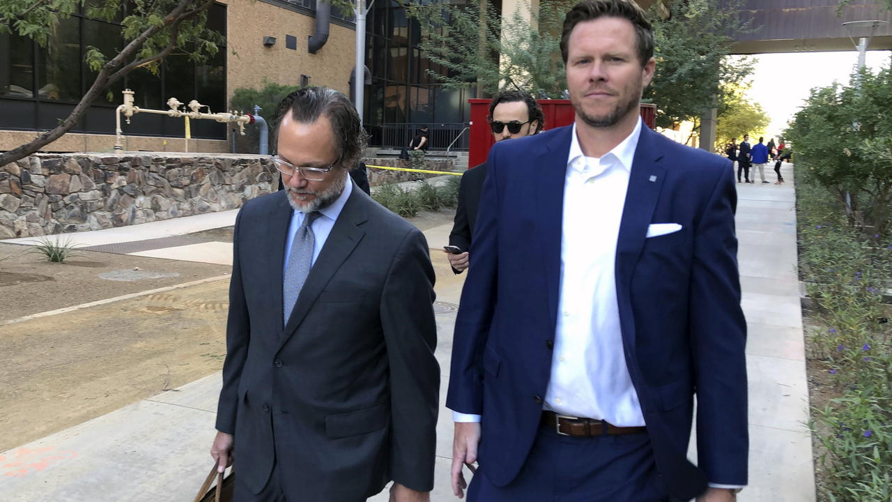 Arizona official charged in adoption smuggling scheme pleads not guilty, threatens to sue over work suspension