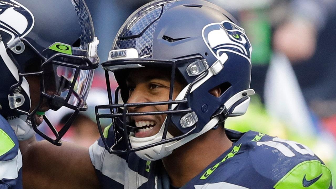 Seattle Seahawks' Tyler Lockett hospitalized after suffering 'severe' lower-leg injury