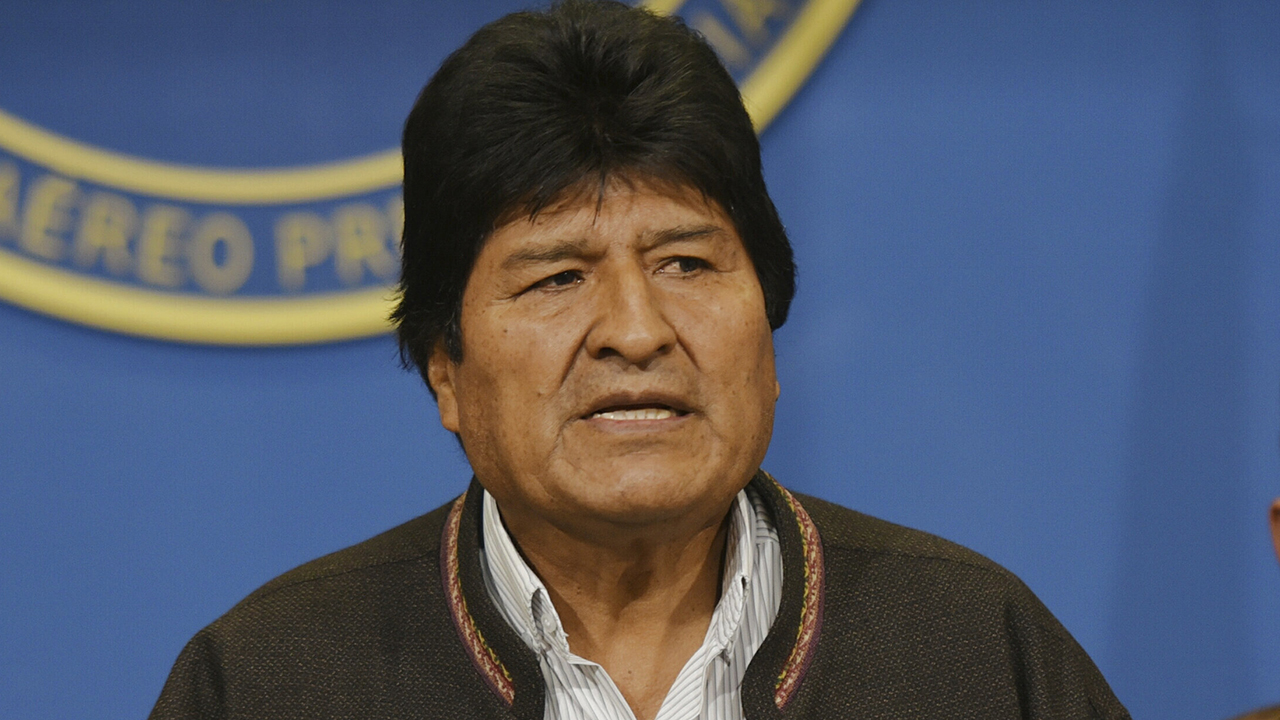 Bolivia ex-president Evo Morales on the run as supporters clash with police, barricade roads