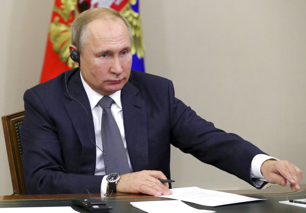Putin signs bills mandating Russian apps on electronic devices, targeting journalists