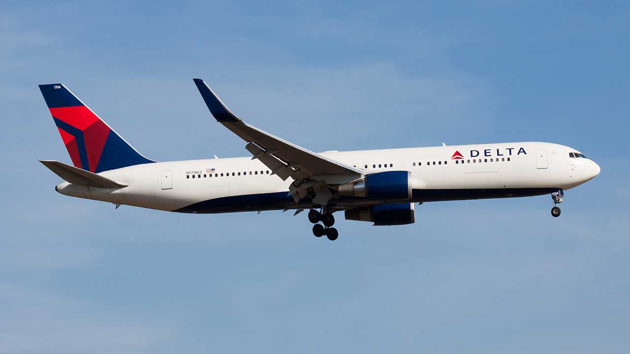 Inflatable emergency slide from Delta aircraft detaches from plane, lands in Massachusetts man's yard