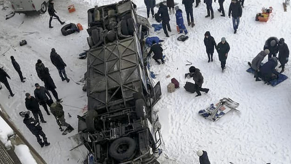 Bus plunges onto frozen river in Siberia, killing 19