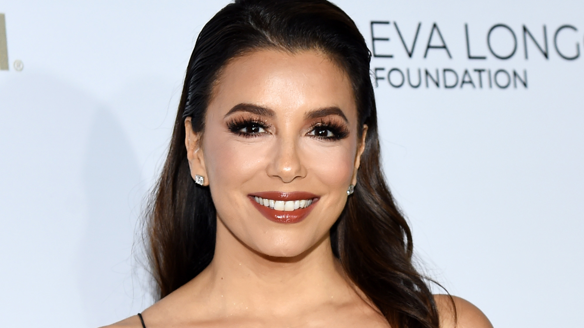 Eva Longoria sizzles in white swimsuit as she enjoys 'fun in the sun' in Mexico