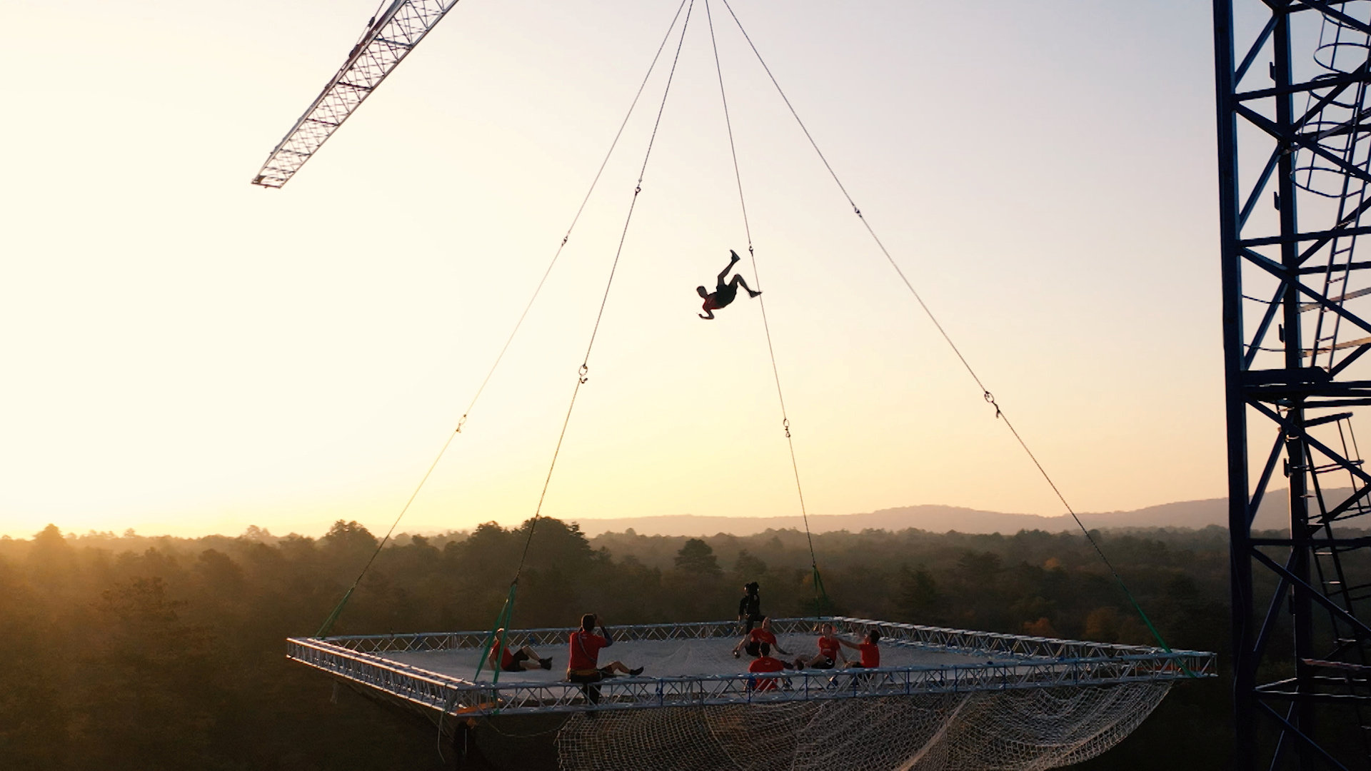 Daredevils build 'world's largest trampoline,' suspend it from crane 100 feet above the earth