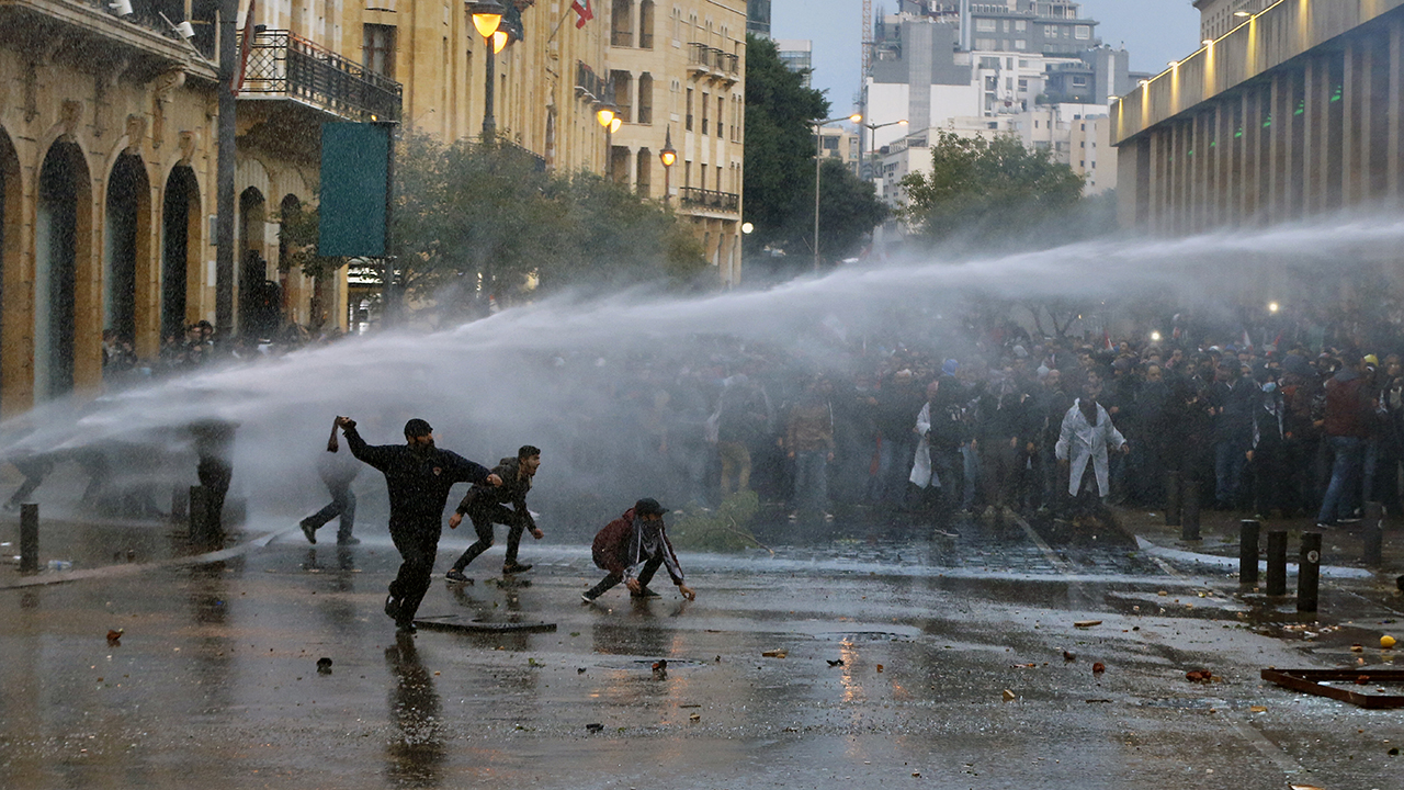 Lebanon police fire tear gas, spray water cannons at protesters amid riots in Beirut