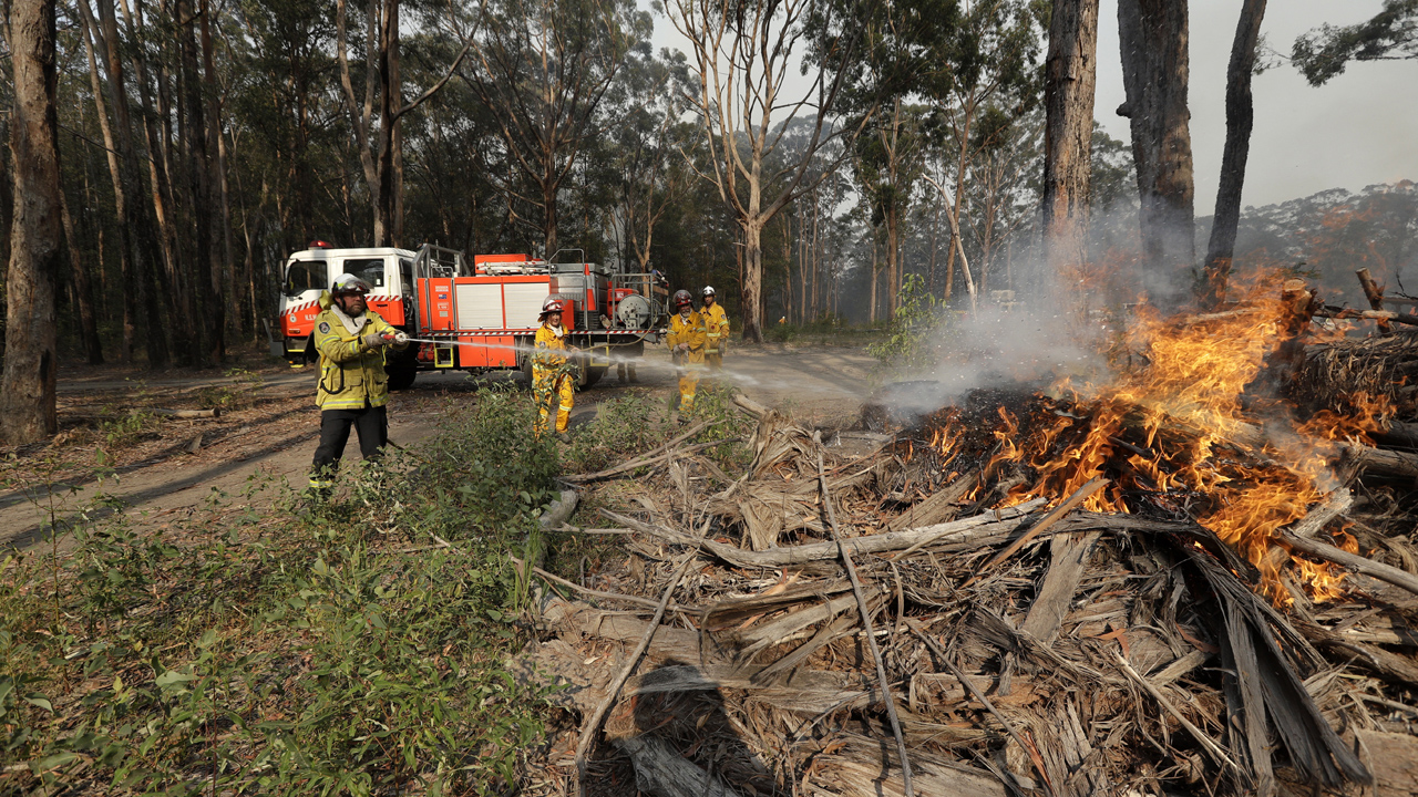 Australian officials charged nearly 200 with fire offenses as deadly wildfires rage