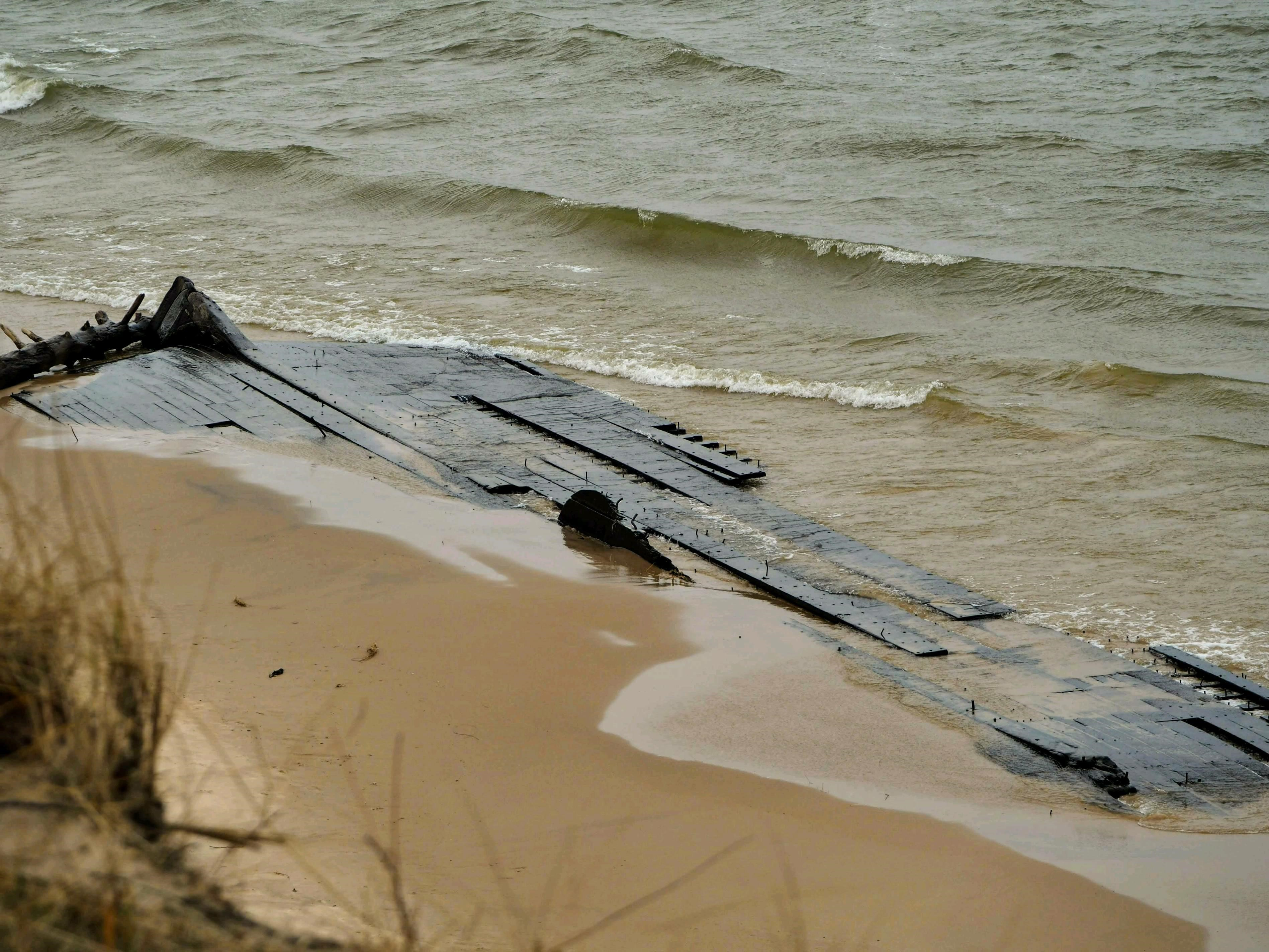 Mysterious shipwreck 'disappears' into Lake Michigan, new photos show