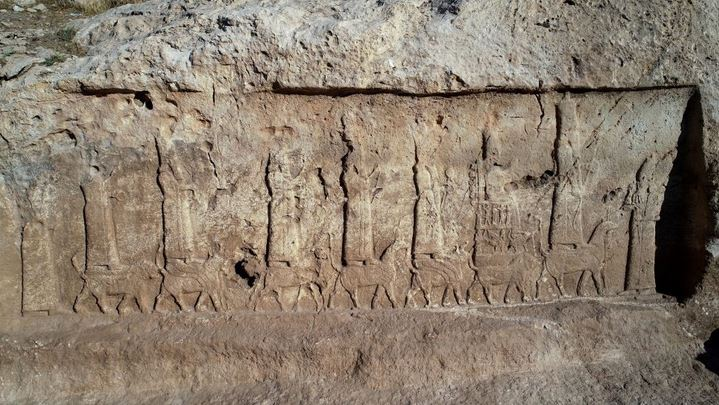 Ancient rock carvings show procession of gods riding mythical animals