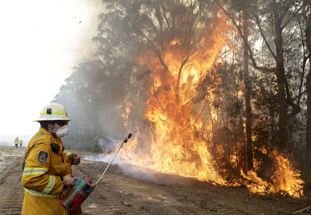 US firefighters cheered at Australia airport as fires worsen, new evacuations ordered
