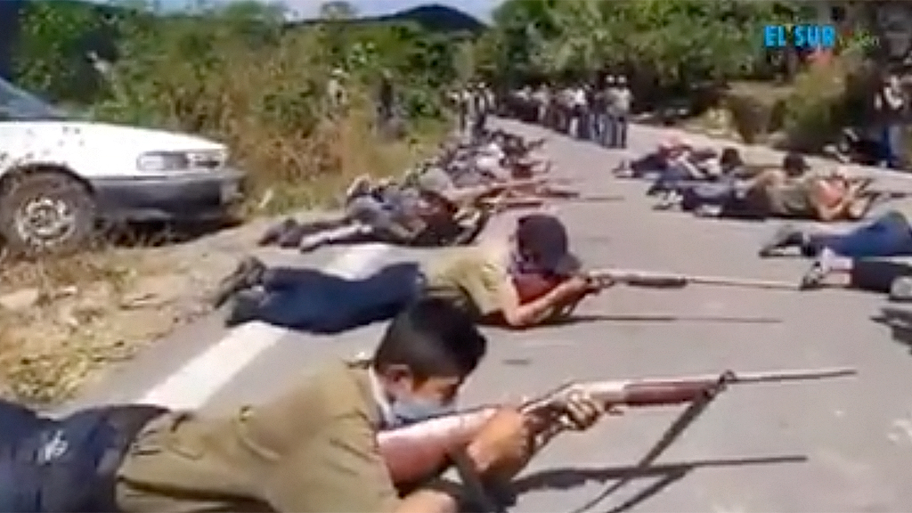 Mexican children pictured taking up rifles for community police force after cartel attack